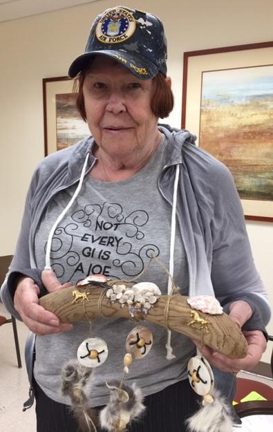 woman veteran shows her art